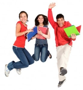 happy students jumping in the air isolated over a white background